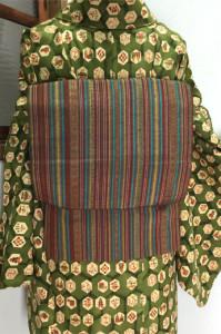 アースカラーのエキゾチックな縞模様ナチュラルモダンな紬名古屋帯